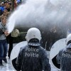 Protesting farmers spray European Parliament with milk